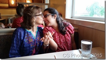 Mom and daughter share a light-hearted moment at breakfast.